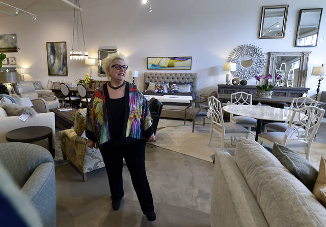 Ronne Kurlancheek stands in her new Forty Fort showroom a year to the day her store in Wilkes-Barre Township was destroyed. Aimee Dilger | Times Leader