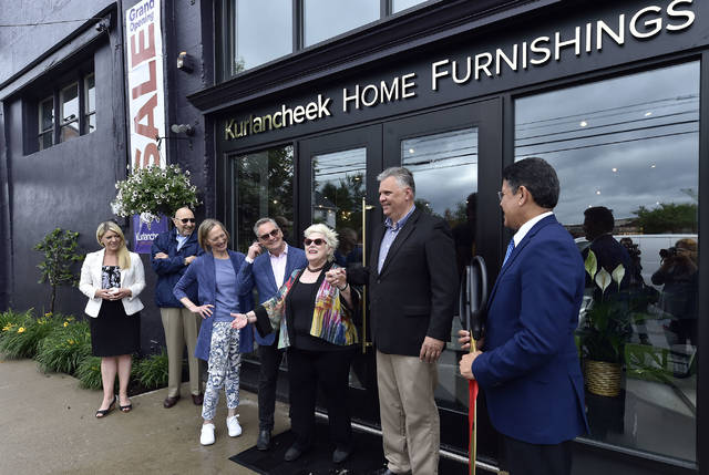 Ronne Kurlancheek stands with Forty Fort Mayor Andy Tuzinski and members of the Wilkes-Barre Chamber for a ribbon cutting at the new Forty Fort showroom on Welles Street. Aimee Dilger | Times Leader