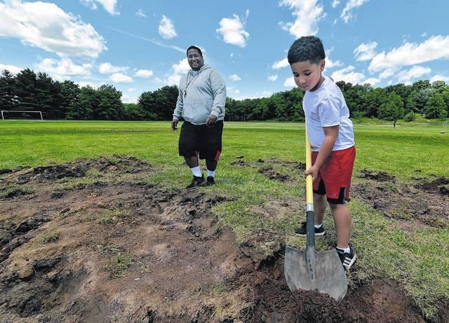 Volunteers transforming Coal Street baseball diamond into home base for football