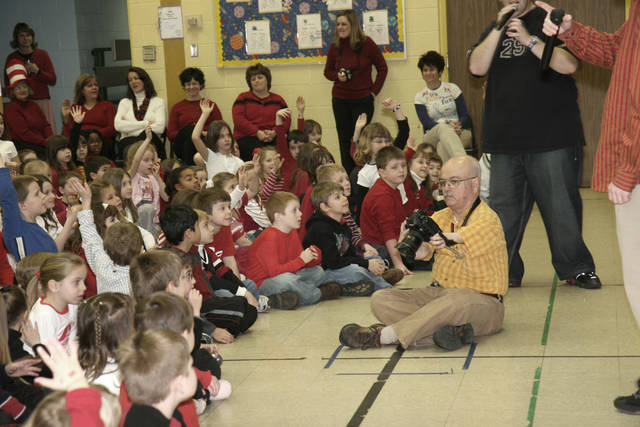 Longtime Times Leader photographer Don Carey is seen photographing a school event. Carey died Sunday at the age of 75. Courtesy Charlotte Bartizek