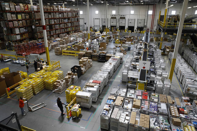 FILE- In this Aug. 3, 2017, file photo, workers prepare to move products at an Amazon fulfillment center in Baltimore. Amazon will spend more than $700 million to provide additional training to about one-third of its U.S. workforce. (AP Photo/Patrick Semansky, File)AP photo