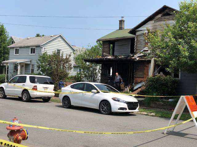 A Pennsylvania state trooper removes evidence from the fatal fire Tuesday morning at 18 Wood St. in Pittston. A state trooper removes evidence from the fatal fire Tuesday morning at 18 Wood St. in Pittston. Jerry Lynott | Times Leader