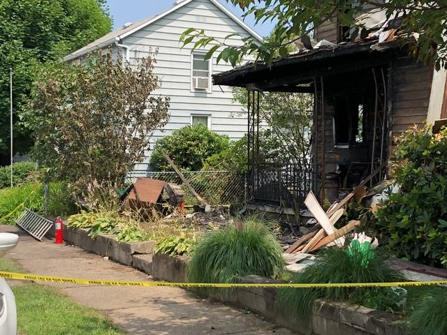 A neighbor said one of the people living at the house at 18 Wood St. in Pittston tried to use a ladder and fire extinguisher to rescue an 11-year-old boy from a second-floor bedroom, but the child died as a result of the blaze that's under investigation. Jerry Lynott | Times Leader