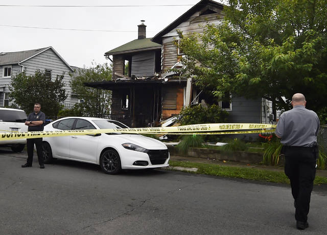 State police tape off an area around 18 Wood St., Pittston on Tuesday following a fatal fire at the home earlier in the day. Aimee Dilger | Times Leader