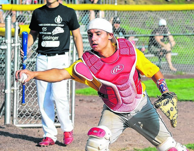 FILE PHOTO — Pocono 1 catcher Dallas Greenwieg, of Pleasant Valley, reaches to tag a West 1 player who scored during the 2018 Keystone State Games at Hilldale Park in Plains Township. Bill Tarutis | For Times Leader