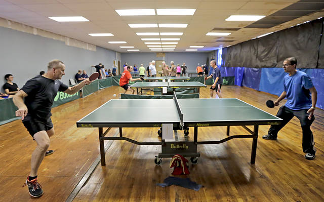 FILE PHOTO — Mark Vtabel, of Hamburg, left, battles it out against Penn State-Scranton physics professor Asif ud-Doula during the 2018 Keystone State Games table tennis tournament in Nanticoke. Bill Tarutis | For Times Leader