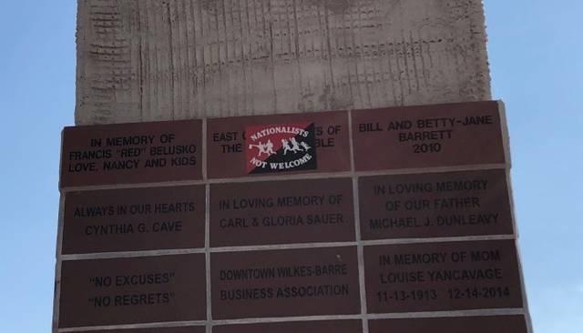 KKK brick on Public Square covered with anti-nationalist sticker