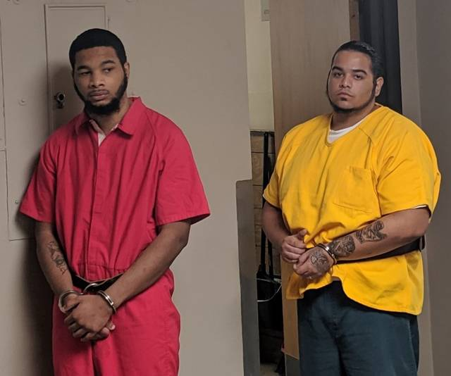 Isaiah Jennings, left, and Robert Rodriguez are escorted in the Luzerne County Courthouse Thursday morning.