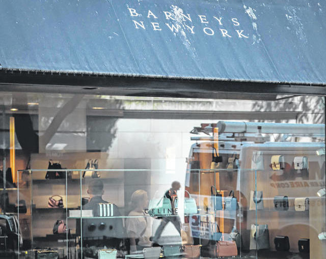 Once a retail shrine , flagship stores lose their shine