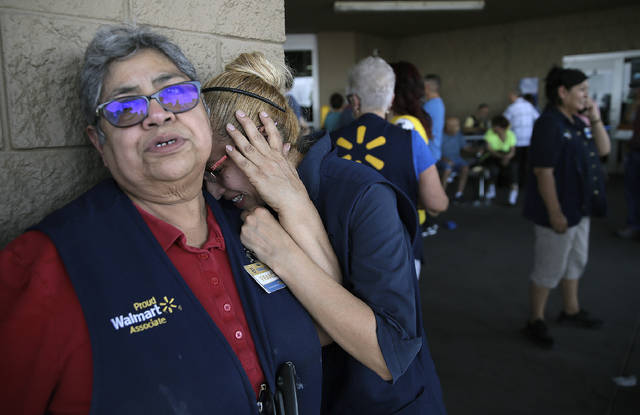 Walmart employees react after an active shooter opened fire at the store in El Paso, Texas, on Saturday.