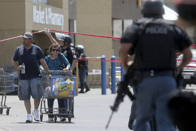 Walmart customers are escorted from the store after a gunman opened fire on shoppers near the Cielo Vista Mall on Saturday in El Paso, Texas. Multiple people were killed and one person was in custody after a shooter went on a rampage at the shopping mall, police in the Texas border town of El Paso said.