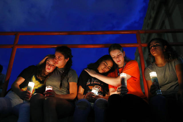 From left, Melody Stout, Hannah Payan, Aaliyah Alba, Sherie Gramlich and Laura Barrios comfort each other during a vigil for victims of the shooting Saturday in El Paso, Texas. A young gunman opened fire in an El Paso, Texas, shopping area during the busy back-to-school season, leaving multiple people dead and more than two dozen injured.