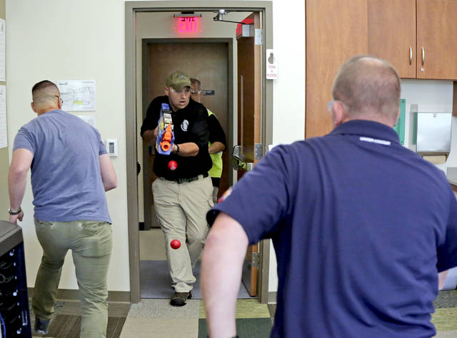 'Active shooter' Henry Giammarco, a senior supervisory special agent with the state attorney general's office, enters a classroom at Bear Creek Community Charter School during an ALICE active shooter training exercise on Wednesday. Bill Tarutis | For Times Leader