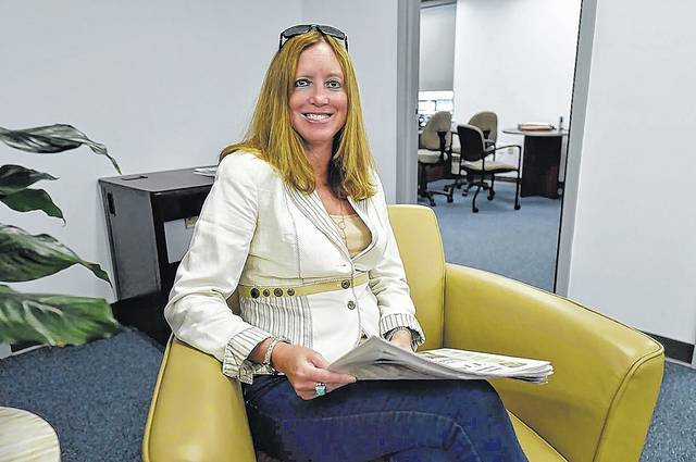 Kerry Miscavage, vice president of sales and marketing, is seen in the Times Leader offices on East Market Street, Wilkes-Barre. 'We have lots of good things to come for our readers and advertisers,' she said. 'Stay tuned!' Aimee Dilger | Times Leader
