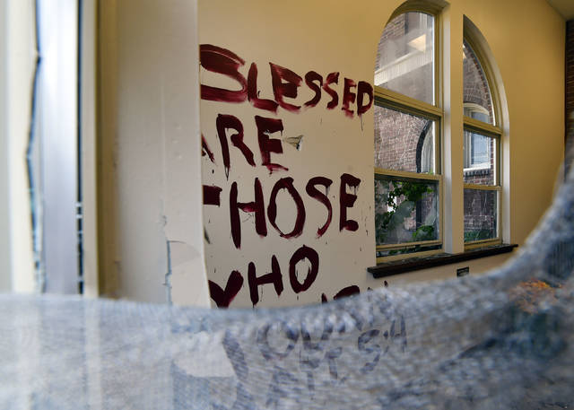 """A biblical quote"""" Blessed are those who mourn. Matt 5:4"""" was painted on the wall at the Wilkes-Barre Planned Parenthood office which can be seen through smashed windows. Aimee Dilger