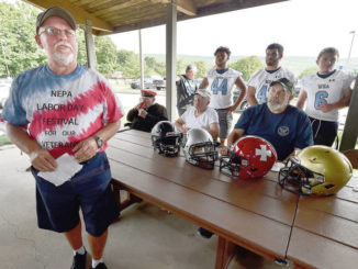 Retired WB Area HS football helmets will be auctioned to benefit veterans