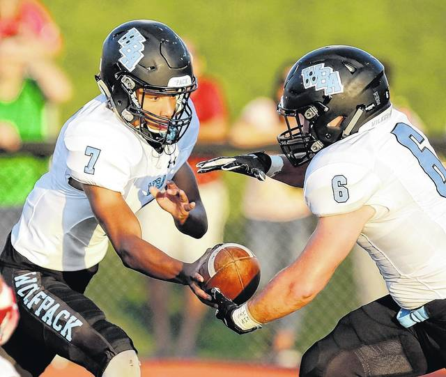 Wilkes-Barre Area quarterback Kam Taylor, left, hands-off to running back Corey Brown against Crestwood Friday night in Wright Township. Bill Tarutis | For Times Leader