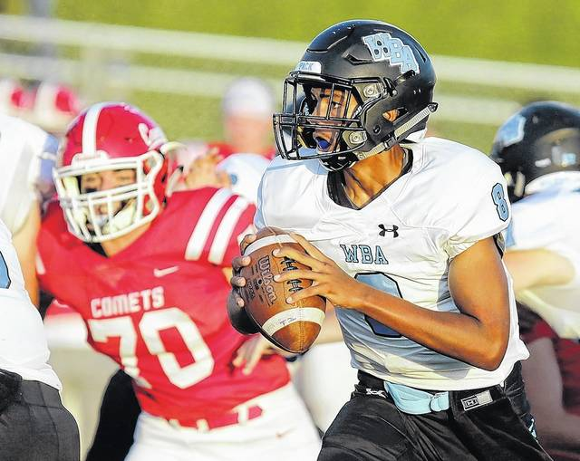 Wilkes-Barre Area quarterback Talee Swinney looks to pass against Crestwood Friday night in Wright Township. Bill Tarutis | For Times Leader