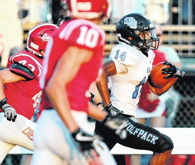 Wilkes-Barre Area's Rafael McCoy, right, races down the left sideline on a kickoff return for a touchdown against Crestwood Friday night. Bill Tarutis | For Times Leader