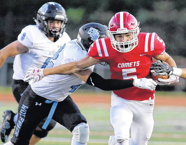 Crestwood's Ryan Miller, right, runs through a Wilkes-Barre Area tackler Friday night in Wright Township. Bill Tarutis | For Times Leader