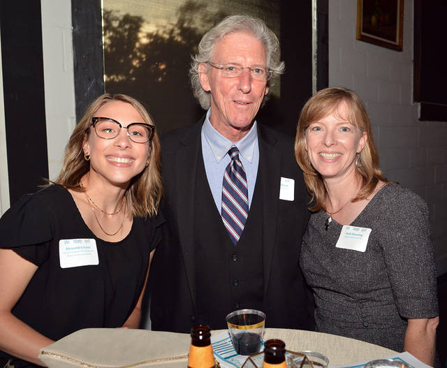 Alexandra Isaac, coordinator of Gallery Programs at the Pauly Friedman Art Gallery at Misericordia University, a 2019 Cultural Ambassador of the Year finalist, left, stands with university colleagues, Jim Haberski and Heidi Manning at the start of The Greater Wilkes-Barre Chamber of Commerce's Young Professionals Awards held at The Room at 900, Forty Fort, on Tuesday. Tony Callaio | For Times Leader