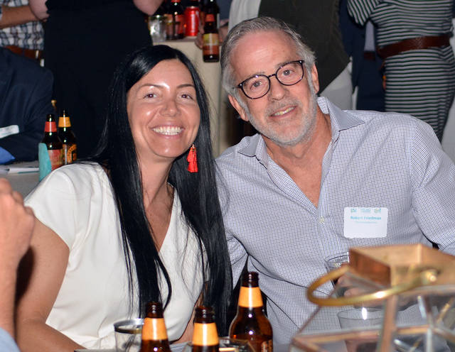 The third annual Young Professionals Awards' double finalist Nicole Farber, CEO at ENX2 Marketing, chats with local restaurateur Rob Friedman inside the Room at 900 in Forty Fort on Tuesday. Tony Callaio | For Times Leader