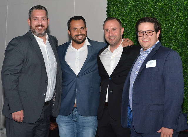 The Greater Wilkes-Barre Chamber of Commerce's 2019 Entrepreneur of the Year honors went to Brian Stanchak of The BDS Agency, LLC, for the third annual Young Professionals Awards on Tuesday. From left, are Joseph Boylan, Wilkes-Barre Connect executive director; John Phillips, MCR Productions owner; Stanchak; Timothy Ooms, Wilkes-Barre Connect economic development analyst. Tony Callaio | For Times Leader