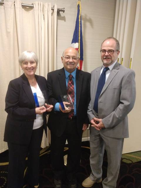 Jan Thyren and Gary Van Scoy were presented with the Community Partner Award from the Disaster Recovery Coalition of Luzerne County at a breakfast meeting Friday at Holiday Inn East Mountain. Mike Zimmerman, outgoing CEO at Family Service Association, right, presented the awards.
