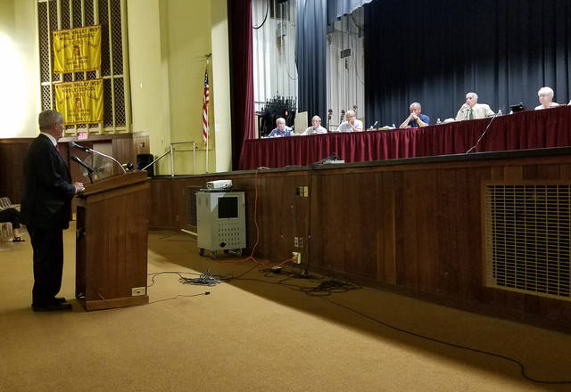 Luzerne County Community College President Thomas Leary pitches LCCC's 'Early College' program to the Wyoming Valley West School Board at Wednesday's monthly meeting in the Middle School. Mark Guydish | Times Leader