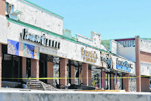 These buildings were severely damaged by the June 13 tornado and have been demolished. The property owner/developer, Urban Edge Properties of New Jersey, plans to rebuild on the site, including a separate building that will house Panera Bread. Times Leader File