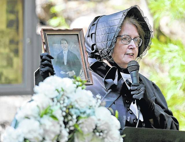 Plymouth Historical Society member Mary Beth Kondrad holds a photo of her great-great grandfather and Avondale mine disaster victim John D. Evans during a commemorative service noting the 150th anniversary of the event Sunday in Plymouth Township. Bill Tarutis | For Times Leader