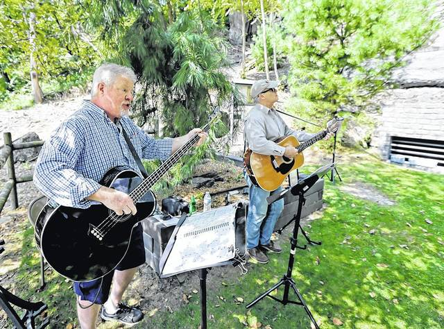 Don Sennett, left, and Don Shappelle, both of Wilkes-Barre, perform 'He's Only a Miner' near the mine shaft entrance during the 150th anniversary service of the Avondale mine disaster in Plymouth Township on Sunday. Bill Tarutis | For Times Leader