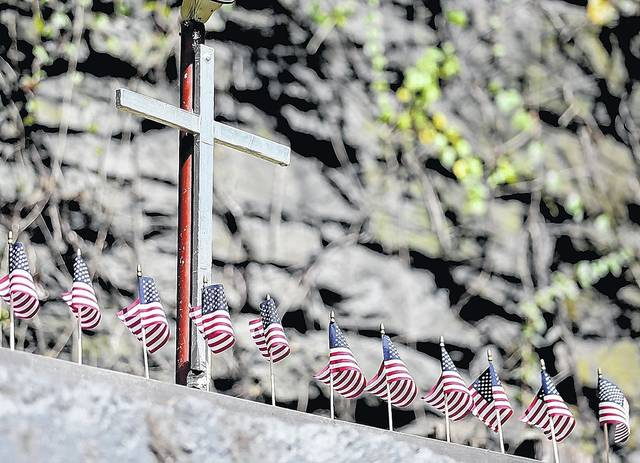 A cross and flags are seen overlooking the Avondale mine site in Plymouth Township. Bill Tarutis | For Times Leader