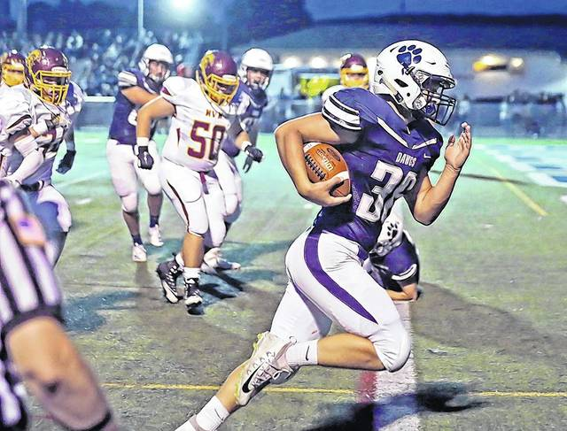 Berwick linebacker Dallas Schechterly runs back an interception for a 14-yard touchdown against Wyoming Valley West Friday night at Crispin Field in Berwick. Bill Tarutis | For Times Leader