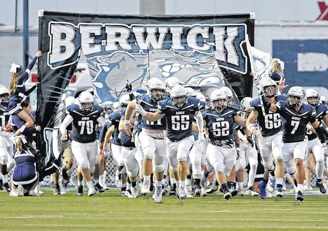 The Berwick Bulldogs storm Crispin Field to take on the Wyoming Valley West Spartans Friday night in Berwick. Bill Tarutis | For Times Leader