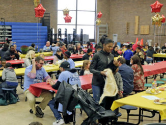 Signature Day for Caring brings improvements to school