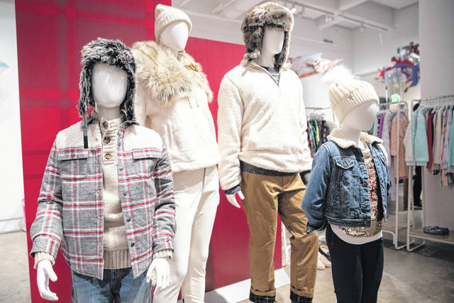Clothing is displayed during a Target Holiday Outlook event in New York. Target Corp. says it's spending $50 million more on payroll during the fourth quarter than it did a year ago so that there'll be more workers on hand to help harried shoppers scrambling to get their shopping done in a shorter amount of time. AP photo