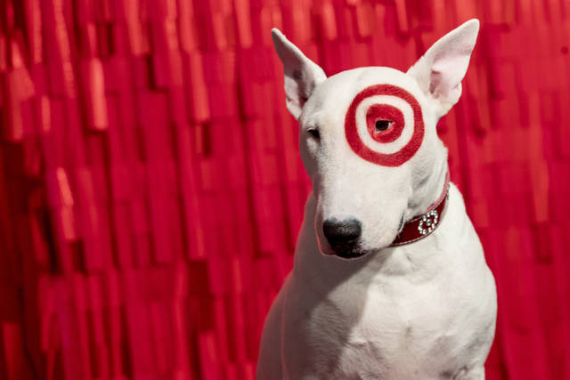 In this Wednesday, Oct. 23, 2019, photo Bullseye, a Miniature Bull Terrier and the official mascot of Target Corporation, poses for a photograph during a Target Holiday Outlook event in New York. Target Corp. says it's spending $50 million more on payroll during the fourth quarter than it did a year ago so that there'll be more workers on hand to help harried shoppers scrambling to get their shopping done in a shorter amount of time. (AP Photo/Mary Altaffer)