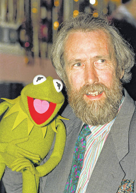 Jim Henson, creator of the Muppets, poses with Kermit the Frog in 1988.