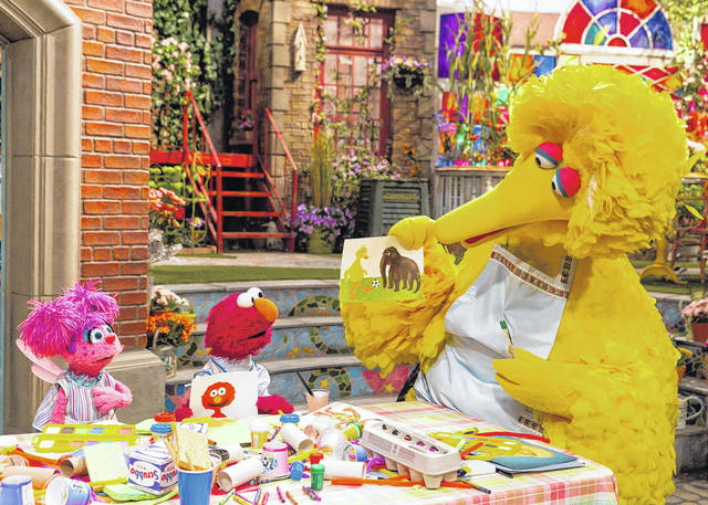 This image released by HBO shows characters, from left, Abby Cadabby, Elmo and Big Bird in a scene from 'Sesame Street.' The popular children's TV show is celebrating its 50th season.