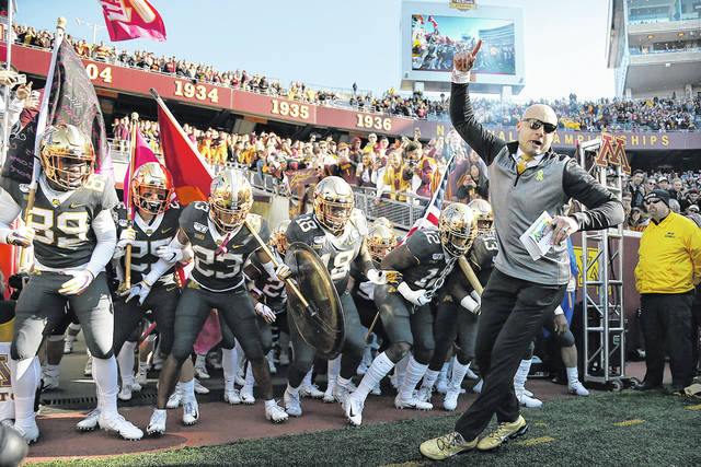Minnesota head coach P.J. Fleck leads him team on the field prior to a game against Maryland in Minneapolis. Penn State (8-0) plays against Minnesota (8-0) on Saturday.