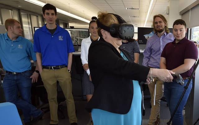 Eileen Cipriani from the Department of Labor and Industry tries out a virtual reality device while meeting with local interns at Borton and Lawson to highlight the State/Local Internship program for young adults last summer. Aimee Dilger | Times Leader