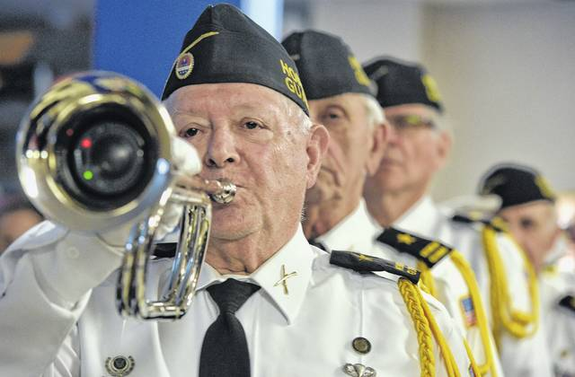 The AMVETS Post 189, led by Joe Sylvester, plays 'Taps' at the VA Veterans Day Ceremony Friday in Plains Township. Aimee Dilger | Times Leader
