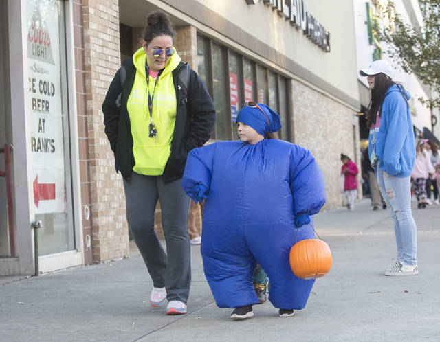 Beth Graziano of Glen Lyon walks around with her son Louis, 8, during the trick-or-treating event. Amanda Hrycyna | For Times Leader