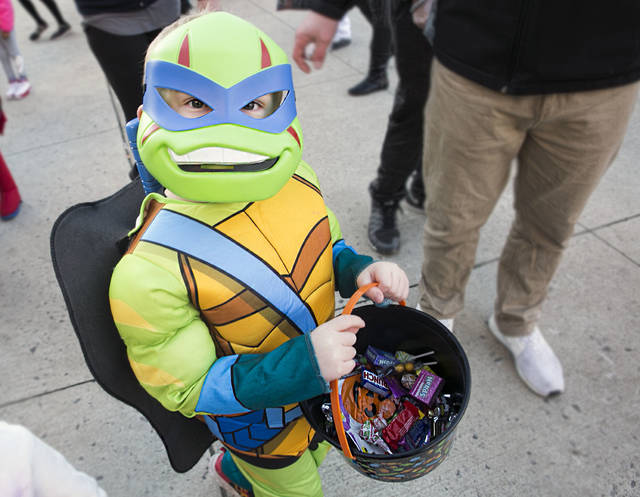 Zachery Budziak, 4 of Nanticoke, dressed as a Ninja Turtle, smiles for the camera while trick-or-treating on Public Square in Wilkes-Barre Friday night. Amanda Hrycyna | For Times Leader