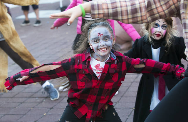 Jazlynn Waters, 5, of Wilkes-Barre dances with her flash mob to Michale Jackson's 'Thriller' in Midtown Village in Wilkes-Barre Friday night. Amanda Hrycyna | For Times Leader