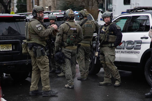 Law enforcement arrives at the scene of a shooting in Jersey City, New Jersey on Tuesday. AP photo
