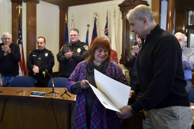 Charlotte Raup receives a proclamation and a key to the city for her work in the community with Wilkes-Barre Crime Watch Coalition from Wilkes-Barre Mayor Tony George. Aimee Dilger | Times Leader