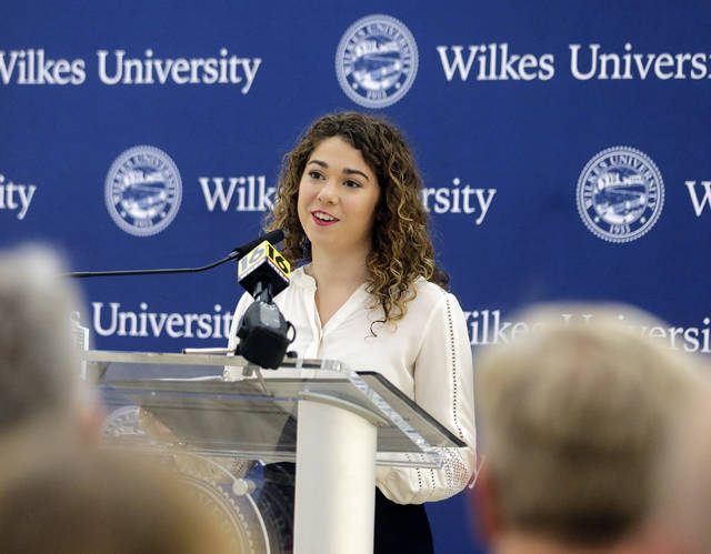 Wilkes University senior communication studies major Caroline Rickard, who served on the presidential search committee, offers remarks Thursday. Bill Tarutis | For Times Leader