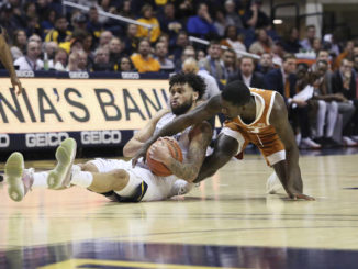West Virginia cruises to win over Texas